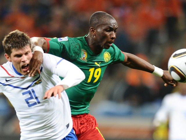 Cameroon midfielder Stephane Mbia battles for possession against Holland on June 24, 2010.