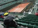 A tarpaulin covers the Philippe Chatrier court as the rain falls ahead of a French Open quarter final match at the Roland Garros, Paris on June 4, 2014