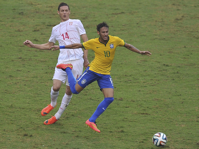 Serbia's footballer Nemanja Matic vies for the ball with Brazil's Neymar during a friendly match ahead of the upcoming Brazil 2014 FIFA World Cup, at Morumbi stadium in Sao Paulo, Brazil, on June 6, 2014