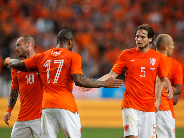 Jeremain Lens of Netherlands celebrates scoring the second goal of the game with Daley Blind and Wesley Sneijder during the International Friendly match between The Netherlands and Wales at Amsterdam Arena on June 4, 201