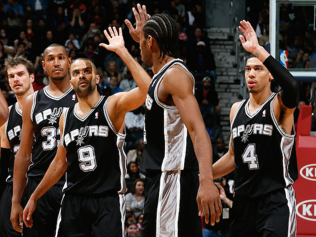 Tiago Splitter, Boris Diaw, Tony Parker, Kawhi Leonard and Danny Green of the San Antonio Spurs celebrate a basket on January 19, 2013
