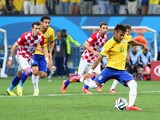 Neymar of Brazil takes a penalty kick in the second half during the 2014 FIFA World Cup Brazil Group A match between Brazil and Croatia at Arena de Sao Paulo on June 12, 2014