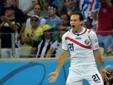 Costa Rica's forward Marco Urena celebrates after scoring during a Group D football match between Uruguay and Costa Rica at the Castelao Stadium in Fortaleza during the 2014 FIFA World Cup on June 14, 2014