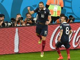 France's forward Karim Benzema celebrates after scoring his teams third goal with midfielder Mathieu Valbuena, during a Group E football match between France and Honduras at the Beira-Rio Stadium in Porto Alegre during the 2014 FIFA World Cup on June 15,