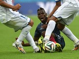 France's midfielder Paul Pogba is tackled by Honduras' midfielder Wilson Palacios (R) during a Group E football match between France and Honduras at the Beira-Rio Stadium in Porto Alegre during the 2014 FIFA World Cup on June 15, 2014