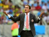 Costa Rica's Colombian coach Jorge Luis Pinto celebrates after Costa Rica's forward Joel Campbell (not seen) scored his team's first goal during a Group D football match between Uruguay and Costa Rica at the Castelao Stadium in Fortaleza during the 2014 F