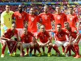 Members of the Swiss national team pose prior to a Group E football match between Switzerland and Ecuador at the Mane Garrincha National Stadium in Brasilia during the 2014 FIFA World Cup on June 15, 2014