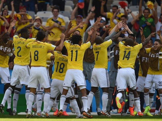 Colombia players celebrate Pablo Armero's opening goal in the World Cup Group C match against Greece on June 14, 2014
