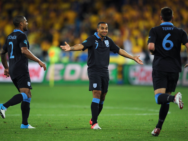 Theo Walcott of England celebrates scoring their second goal during the UEFA EURO 2012 group D match between Sweden and England at The Olympic Stadium on June 15, 2012