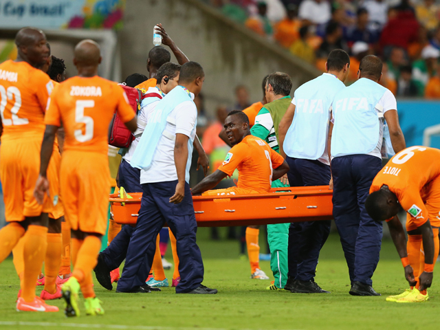 Arthur Boka of the Ivory Coast is carried off the field during the 2014 FIFA World Cup Brazil Group C match between the Ivory Coast and Japan at Arena Pernambuco on June 14, 2014