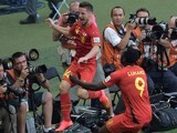 Belgium's midfielder Dries Mertens (L) celebrates after scoring his team's second goal during the Group H football match against Algeria on June 17, 2014