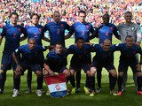 Members of the Netherlands national team pose prior to a Group B football match between Australia and the Netherlands at the Beira-Rio Stadium in Porto Alegre during the 2014 FIFA World Cup on June 18, 2014