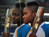 Olympic boxer Nicola Adams holds the Queen's Baton at Burmantofts Amateur Boxing Club on June 12, 201