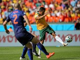 Australia forward Tim Cahill volleys home the equaliser against the Netherlands during their World Cup Group B game in Porto Alegre on June 18, 2014