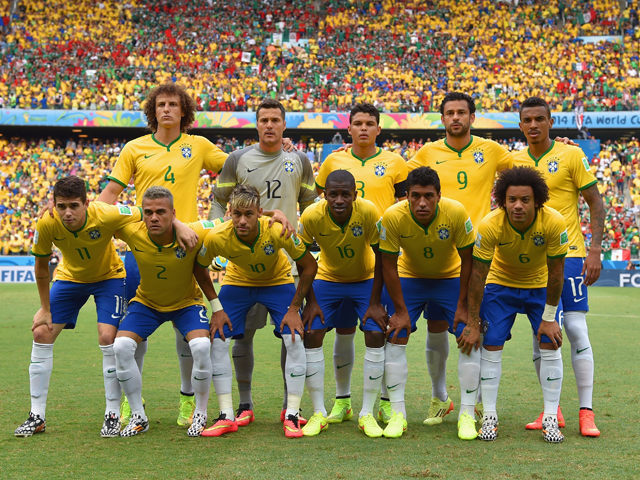 Brazil players pose for a team photo before the 2014 FIFA World Cup Brazil Group A match between Brazil and Mexico at Castelao on June 17, 2014