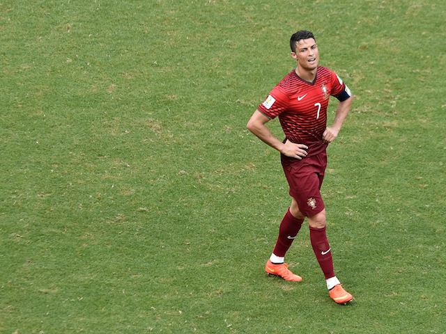 A dejected Cristiano Ronaldo walks away after Portugal lose 4-0 to Germany in their World Cup opener on June 16, 2014.