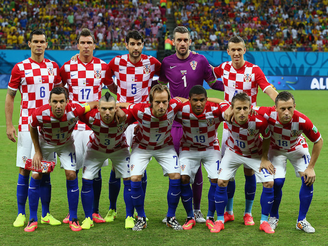 Croatia pose for a team photo prior to the 2014 FIFA World Cup Brazil Group A match between Cameroon and Croatia at Arena Amazonia on June 18, 2014