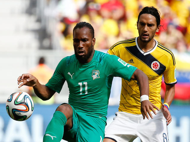 Didier Drogba (L) of the Ivory Coast vies with Abel Aguilar of Colombia during the 2014 FIFA World Cup Brazil Group C match on June 19, 2014