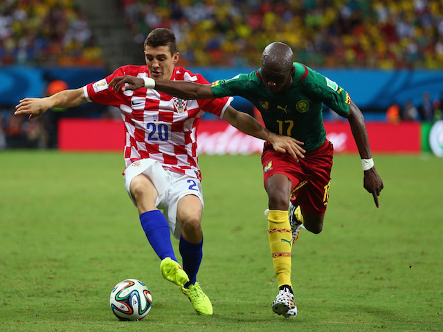 Mateo Kovacic of Croatia controls the ball against Stephane Mbia of Cameroon during the 2014 FIFA World Cup Brazil Group A match on June 19, 2014