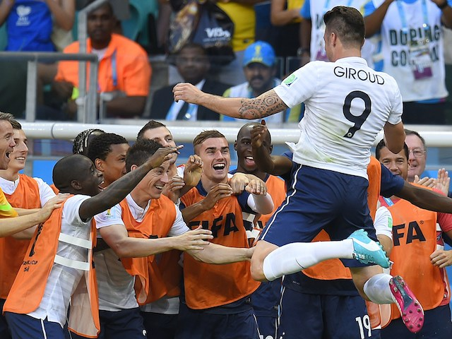 France's forward Olivier Giroud (top R) celebrates scoring his team's first goal during a Group E football match against Switzerland on June 20, 2014