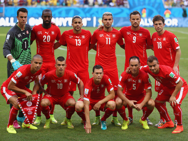 Switzerland players pose for a team photo during the 2014 FIFA World Cup Brazil Group E match between Switzerland and France at Arena Fonte Nova on June 20, 2014