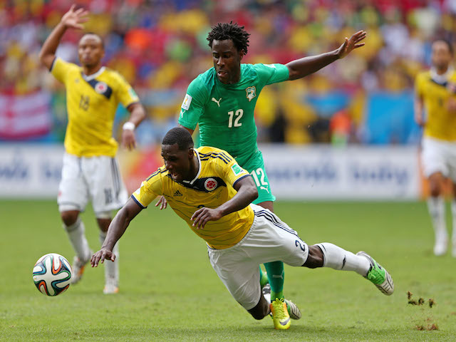 Wilfried Bony of the Ivory Coast and Cristian Zapata of Colombia compete for the ball during the 2014 FIFA World Cup Brazil Group C match on June 19, 2014