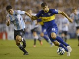 Boca Juniors' defender Emanuel Insua during their Argentine first division football match at Juan Domingo Peron stadium in Avellaneda, Buenos Aires, Argentina, on March 9, 2014