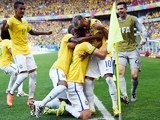 Brazil's defender David Luiz (C) celebrates with teammates after scoring a goal during the round of 16 football match between Brazil and Chile on June 28, 2014