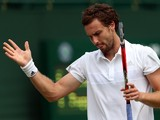 Ernests Gulbis reacts during his Gentlemen's Singles first round match against Jurgen Zopp of Estonia on day one of the Wimbledon Lawn Tennis Championships at the All England Lawn Tennis and Croquet Club at Wimbledon on June 23, 2014