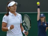 China's Li Na celebrates winning a point against Austria's Yvonne Meusburger during their women's singles second round match on day three of the 2014 Wimbledon Championships at The All England Tennis Club in Wimbledon, southwest London, on June 25, 2014