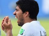 A close-up of Luis Suarez holding his gnashers on June 24, 2014.