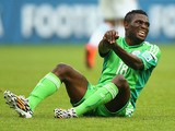Michael Babatunde of Nigeria reacts after a possible injury during the 2014 FIFA World Cup Brazil Group F match against Argentina on June 25, 2014