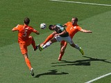 Hector Herrera of Mexico goes for a header against Stefan de Vrij (L) and Ron Vlaar of the Netherlands during the 2014 FIFA World Cup round of 16 match in Fortaleza on June 29, 2014