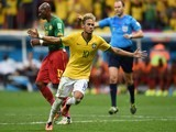 Brazil's forward Neymar celebrates after scoring a second goal during a Group A football match against Cameroon on June 23, 2014