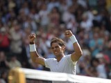 Spain's Rafael Nadal celebrates beating Slovakia's Martin Klizan during their men's singles first round match on day two of the 2014 Wimbledon Championships at The All England Tennis Club in Wimbledon, southwest London, on June 24, 2014