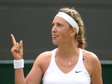 Belarus's Victoria Azarenka celebrates winning her women's singles first round match against Croatia's Mirjana Lucic-Baroni on day one of the 2014 Wimbledon Championships at The All England Tennis Club in Wimbledon, southwest London, on June 23, 2014