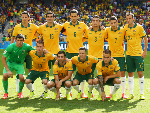 Australia pose for a team photo prior to the 2014 FIFA World Cup Brazil Group B match between Australia and Spain at Arena da Baixada on June 23, 2014