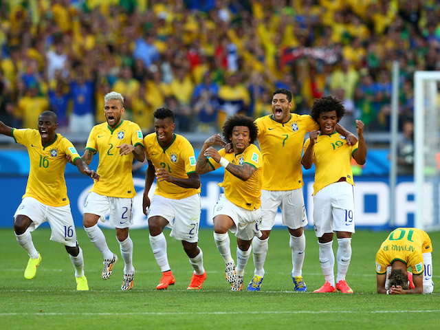 Brazil players celebrate their penalty shootout victory over Chile in the World Cup round of 16 in Belo Horizonte on June 28, 2014