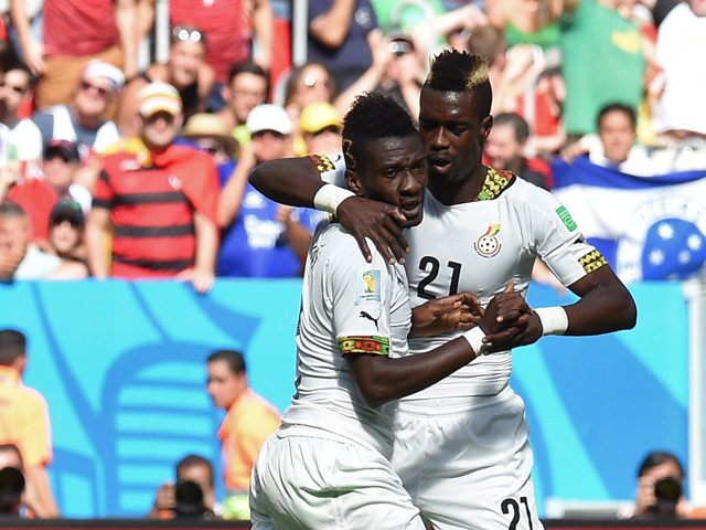 Ghana's forward and captain Asamoah Gyan celebrates with his temmate Ghana's defender John Boye after scoring a goal during the Group G football match between Portugal and Ghana at the Mane Garrincha National Stadium in Brasilia during the 2014 FIFA World