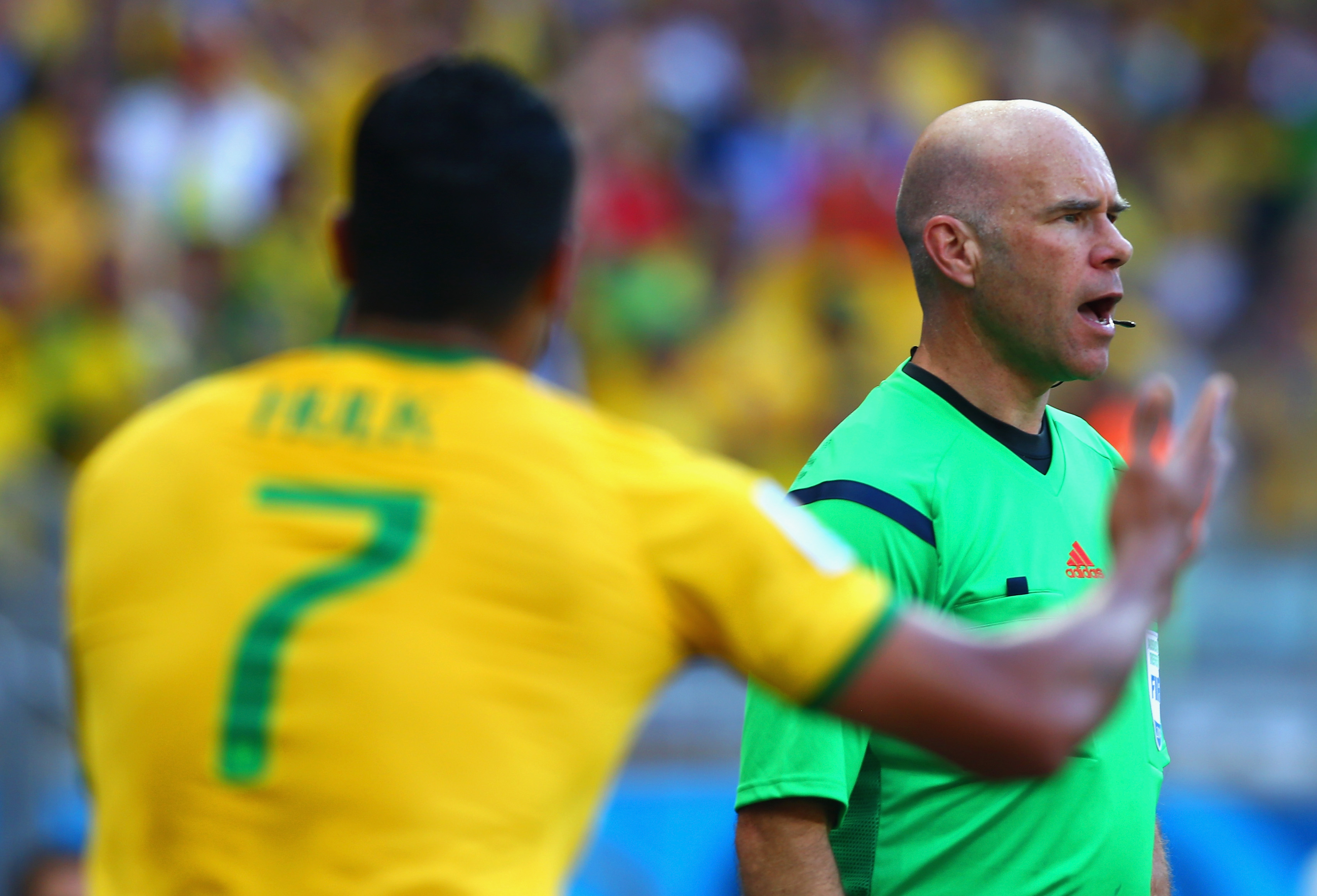 Hulk of Brazil appeals to assistant referee Michael Mullarkey after a disallowed goal and yellow card due to a hand ball during the 2014 FIFA World Cup on June 28, 2014