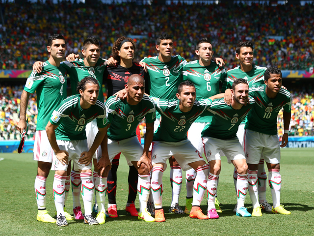 Mexico pose for a team photo prior to the 2014 FIFA World Cup Brazil Round of 16 match between Netherlands and Mexico at Castelao on June 29, 2014