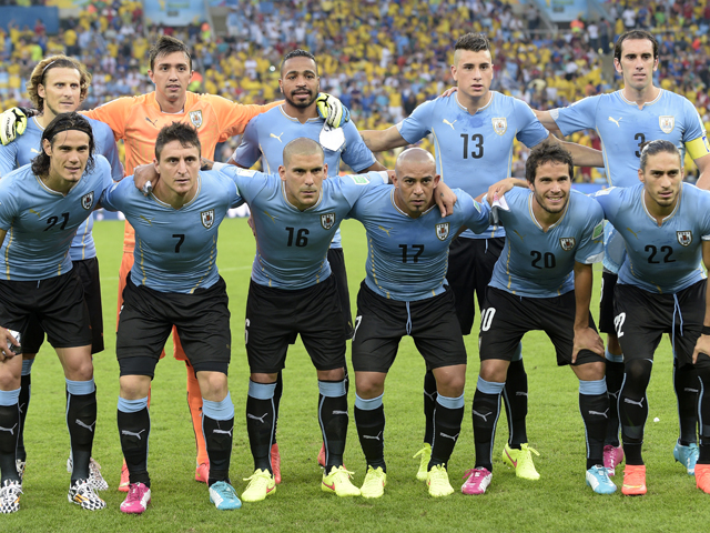 Uruguay players pose before the Round of 16 football match between Colombia and Uruguay at the Maracana Stadium in Rio de Janeiro during the 2014 FIFA World Cup on June 28, 2014