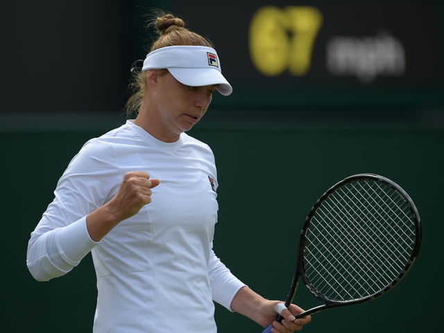 Russia's Vera Zvonareva reacts to winning a point against Britain's Tara Moore during their women's singles first round match on day three of the 2014 Wimbledon Championships at The All England Tennis Club in Wimbledon, southwest London, on June 25, 2014