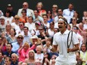 Roger Federer of Switzerland celebrates during the Wimbledon Gentlemen's Singles Final match against Novak Djokovic of Serbia on July 6, 2014
