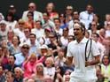 Roger Federer of Switzerland celebrates during the Wimbledon Gentlemen's Singles Final match against Novak Djokovic of Serbia on July 6, 2014