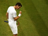 Andy Murray of Great Britain celebrates during his Gentlemen's Singles fourth round match against Kevin Anderson of South Africa on day seven of the Wimbledon Lawn Tennis Championships at the All England Lawn Tennis and Croquet Club on June 30, 2014