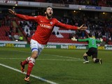 Jim O'Brien of Barnsley celebrates scoring the opening goal during the FA Cup Third Round match between Barnsley and Coventry City at Oakwell on January 4, 2014