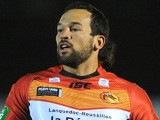 Louis Anderson of Catalan Dragons attacks during the Super League match between London Broncos and Catalan Dragons at Molesey Road on March 28, 2013