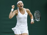 Czech Republic's Lucie Safarova celebrates winning her women's singles fourth round match against Czech Republic's Tereza Smitkova on day seven of the 2014 Wimbledon Championships at The All England Tennis Club in Wimbledon, southwest London, on June 30,