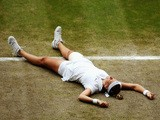 Petra Kvitova of Czech Republic celebrates championship point during the Ladies' Singles final match against Eugenie Bouchard on July 5, 2014